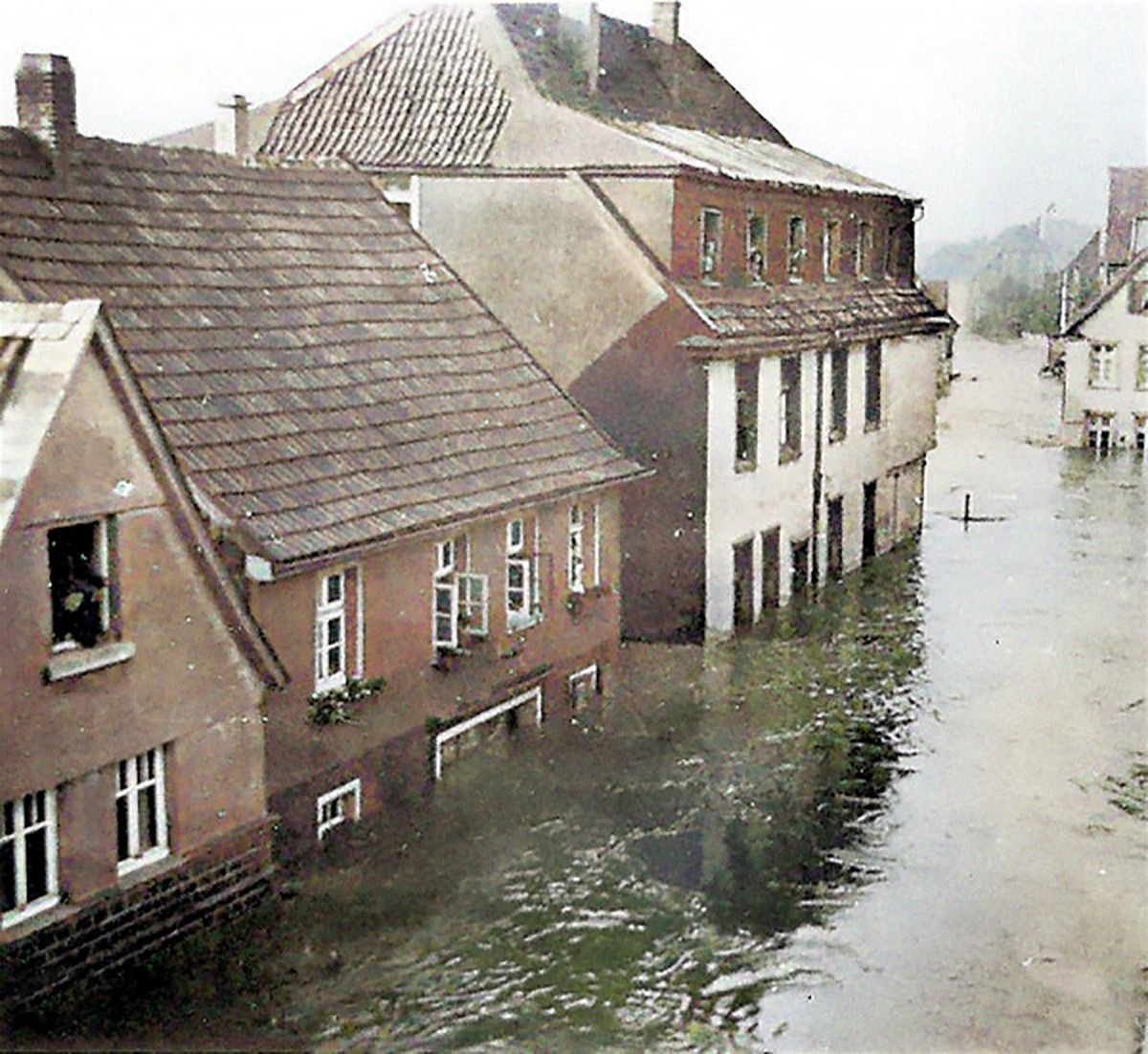 Residents, stare in amazement, at the rising waters: the destruction of the dams at Möhne and Edersee devastated not only arable land and local industry, but also family homes