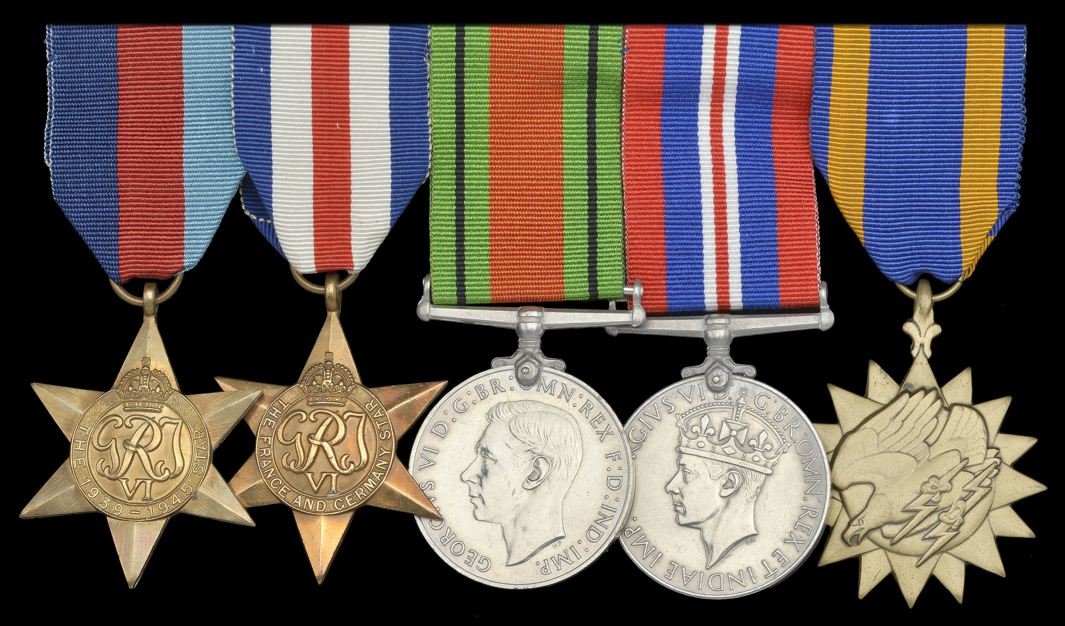 The NW Europe group to Flight Sgt SH Webster, RAFVR, typical of those awarded for Market Garden, with the American Air Medal (right)
