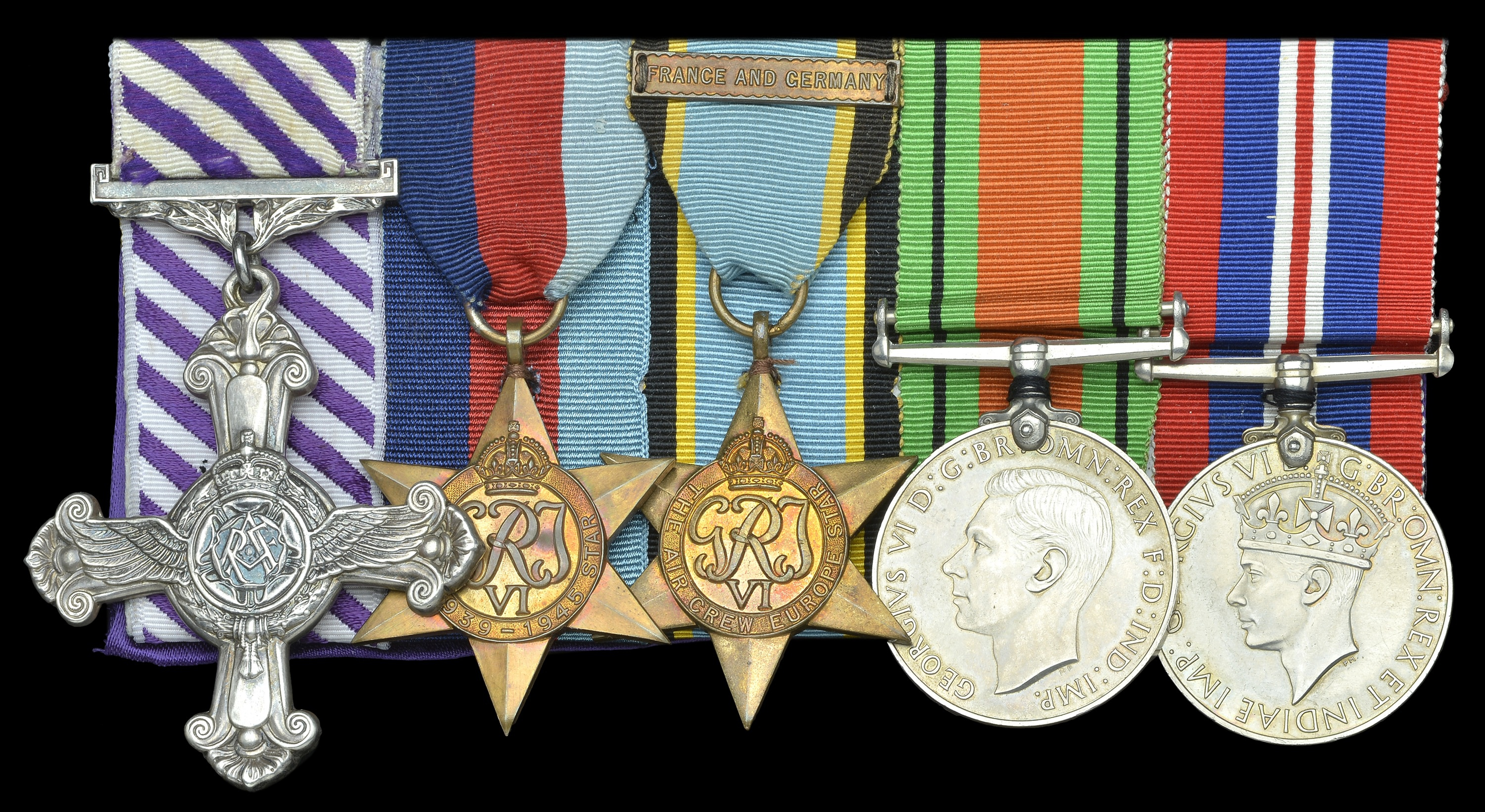 The Distinguished Flying Cross (left) in an RAF group which has the RAF award, the Air Crew Europe Star, with the additional ribbon clasp 'France and Germany' to show service in NW Europe after 6 June 1944