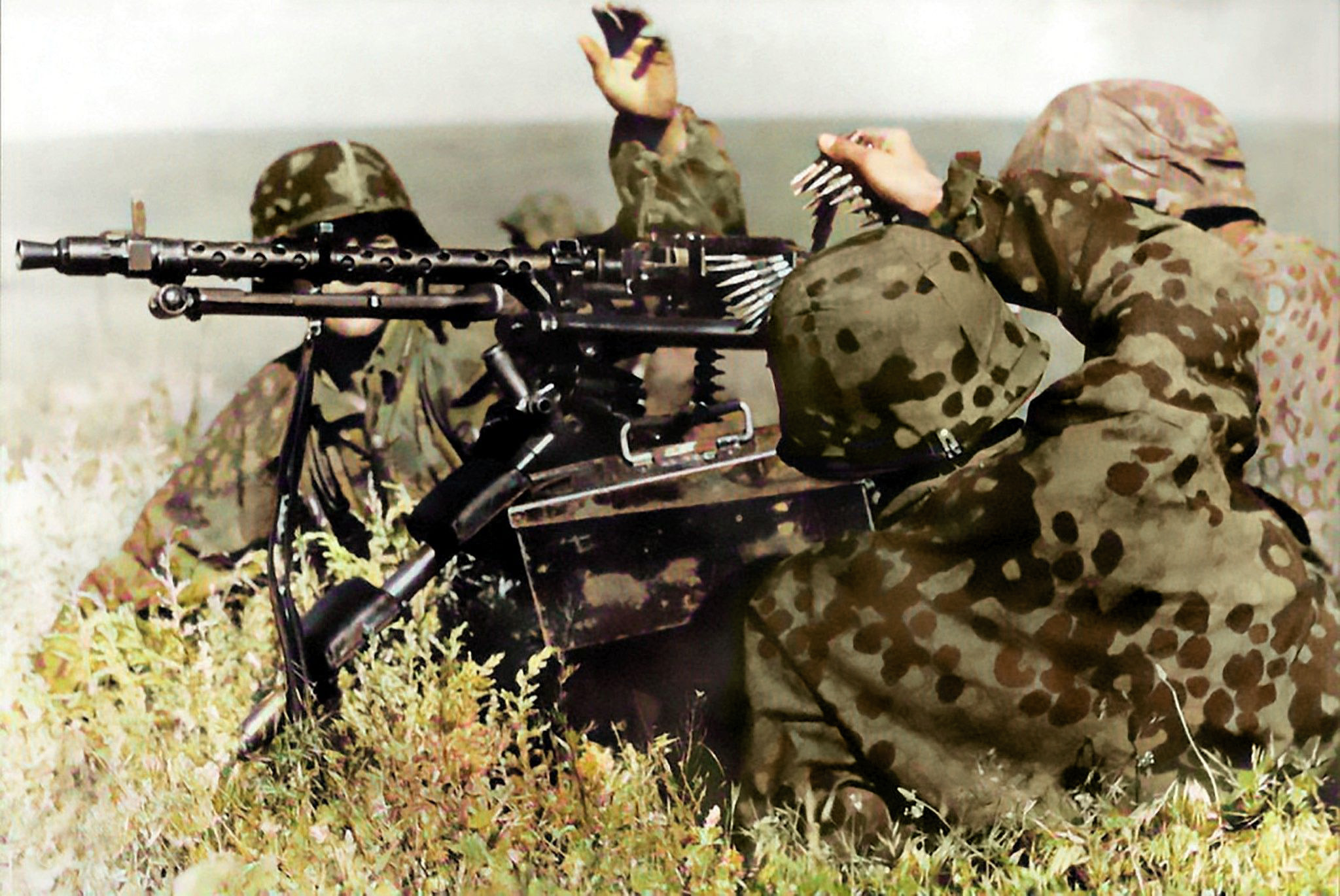 Waffen-SS with MG34 on tripod showing camouflage uniforms out in the field