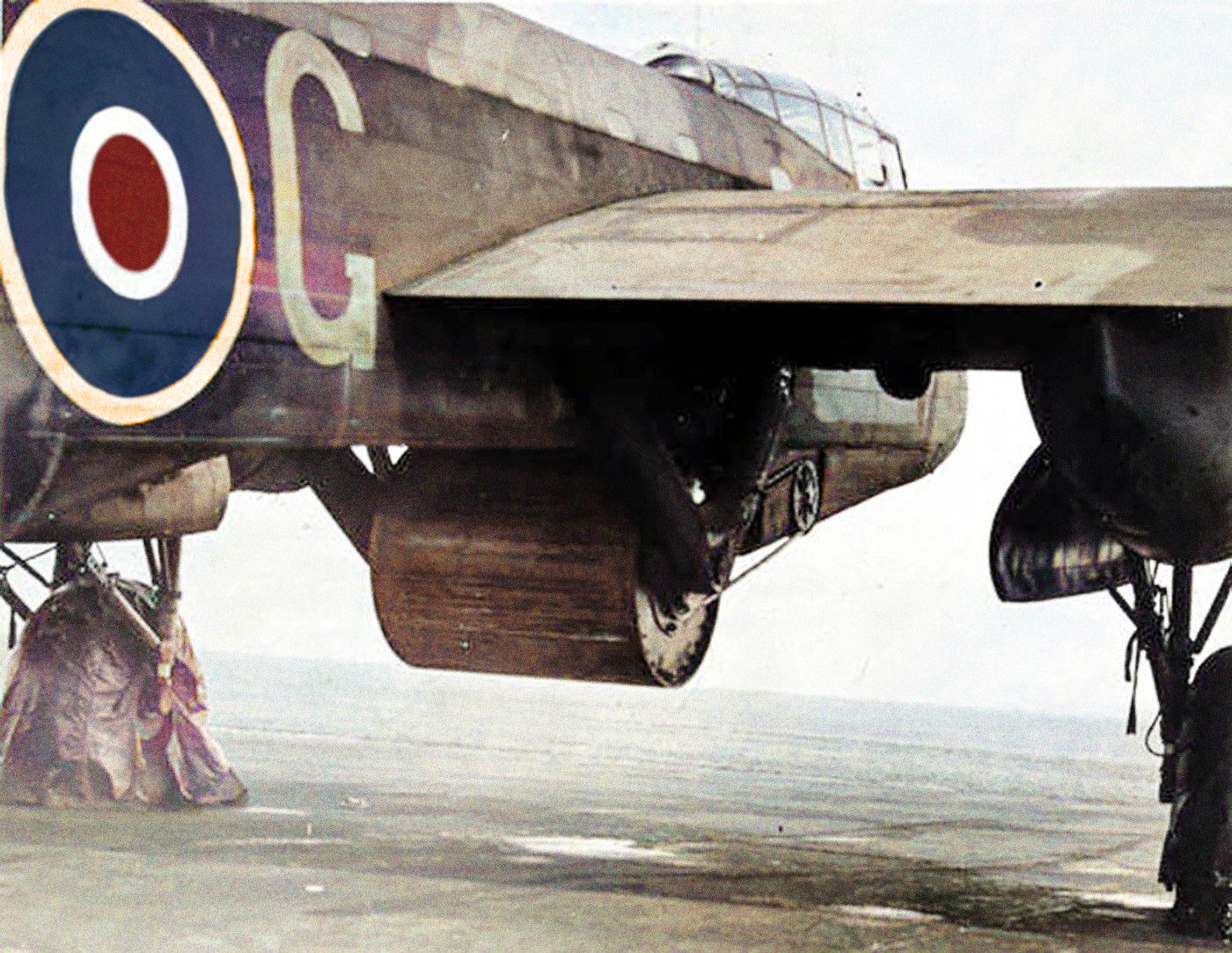 Specially modified Lancasters were designed to carry Upkeep. The bomb was held in place by a pair of calipers (or carrying arms), while backspin was imparted via a belt driven by a hydraulic motor