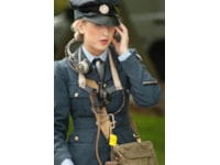 This 1940's WAAF reenactor is wearing an original WWII hands-free communication headset
