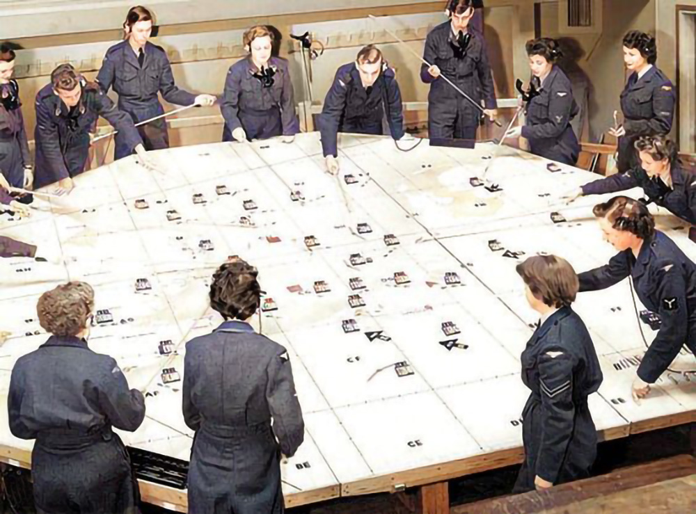 A typically busy plotting staff, seen here controlling over 20 different friend and foe aircraft plots across the operations room plotting table