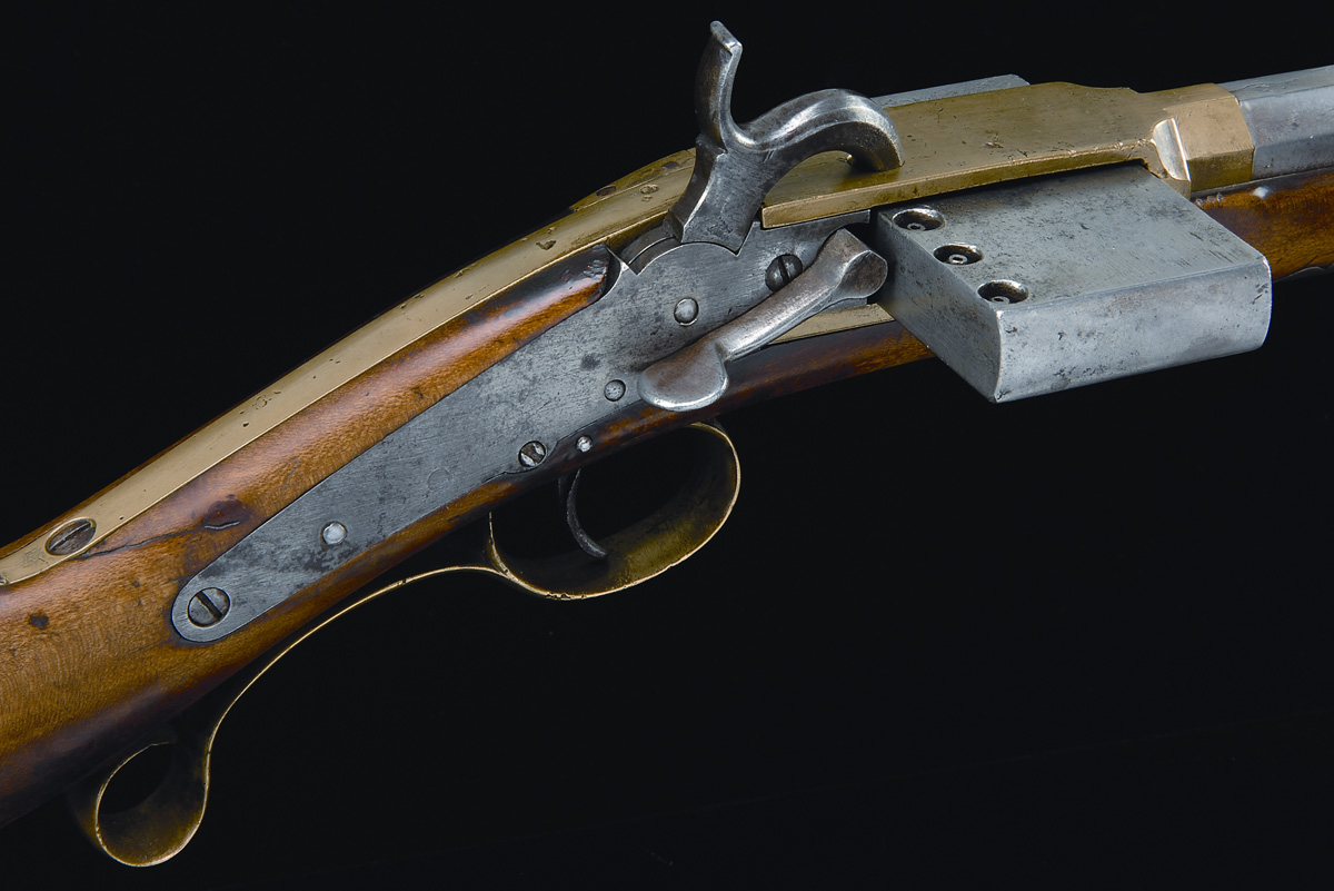 Magnified view of Browning Harmonica rifle, showing the percussion hammer, securing lever for the magazine, and the percussion cones mounted on top of the magazine (James D. Julia Auctioneers)