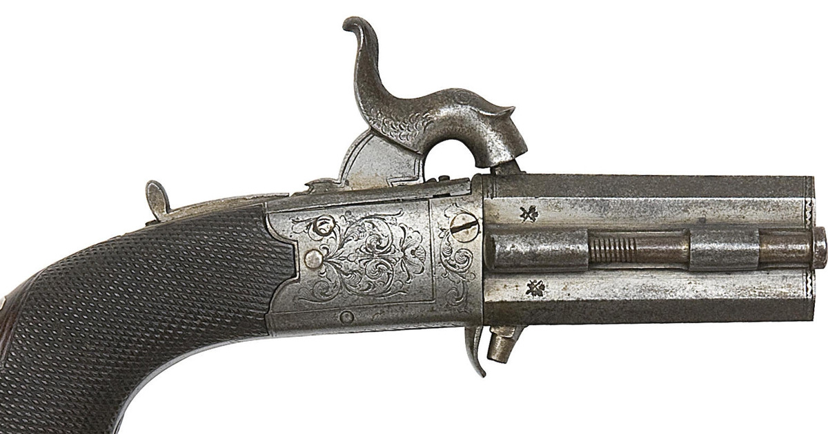 An over-and-under percussion turn-barrel pistol, probably made in Birmingham, as the barrel bears view and definitive proof marks from the Birmingham house (Bonhams)
