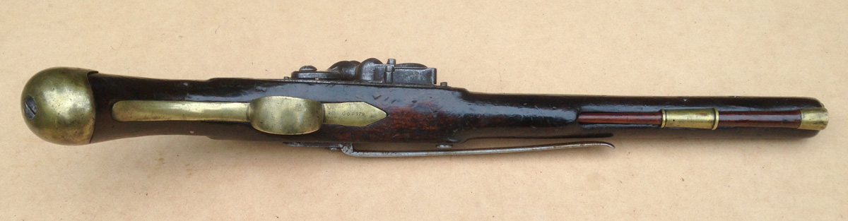 Underside view shows the trigger-guard profile of this pistol type, which differs from a Royal Navy Sea Service Pistol