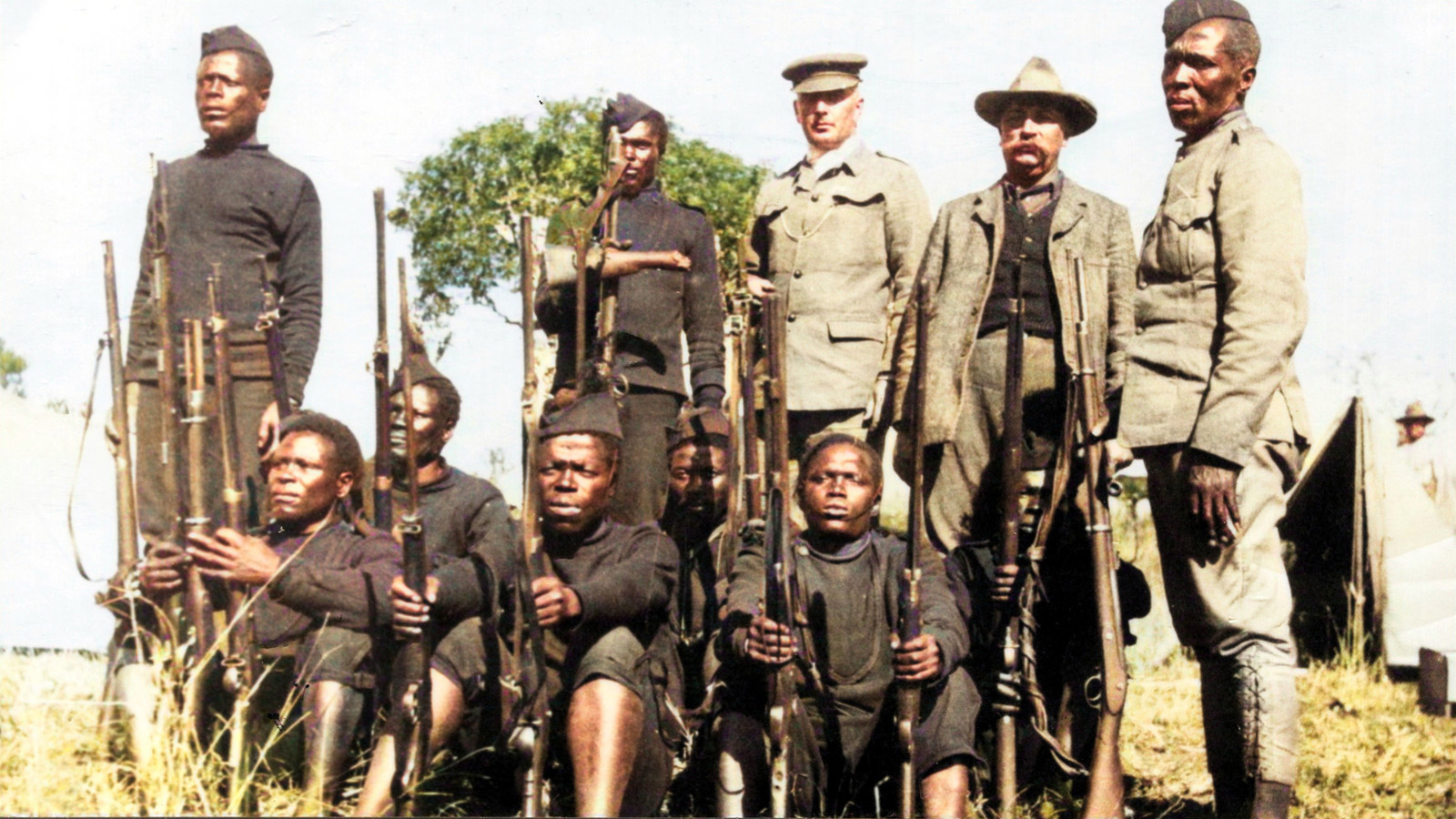 Men of the Zululand native police (Nongqayi) with rebel firearms captured at Mome. The man centre back is holding the butt of a musket smashed by a bullet
