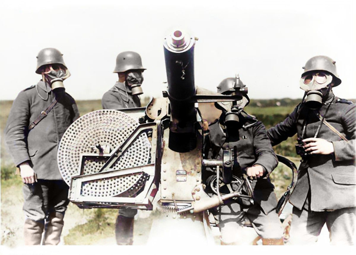 German troops manning an anti-aircraft gun and wearing GM-15 Pattern gas masks