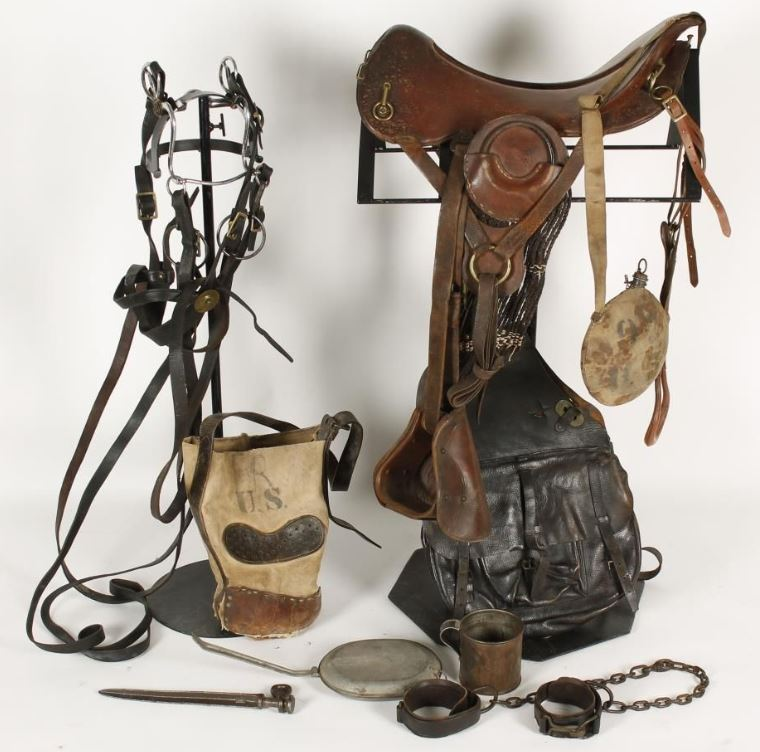 A selection of cavalry equipment including saddle, bit and hobbles dating from the Indian Wars