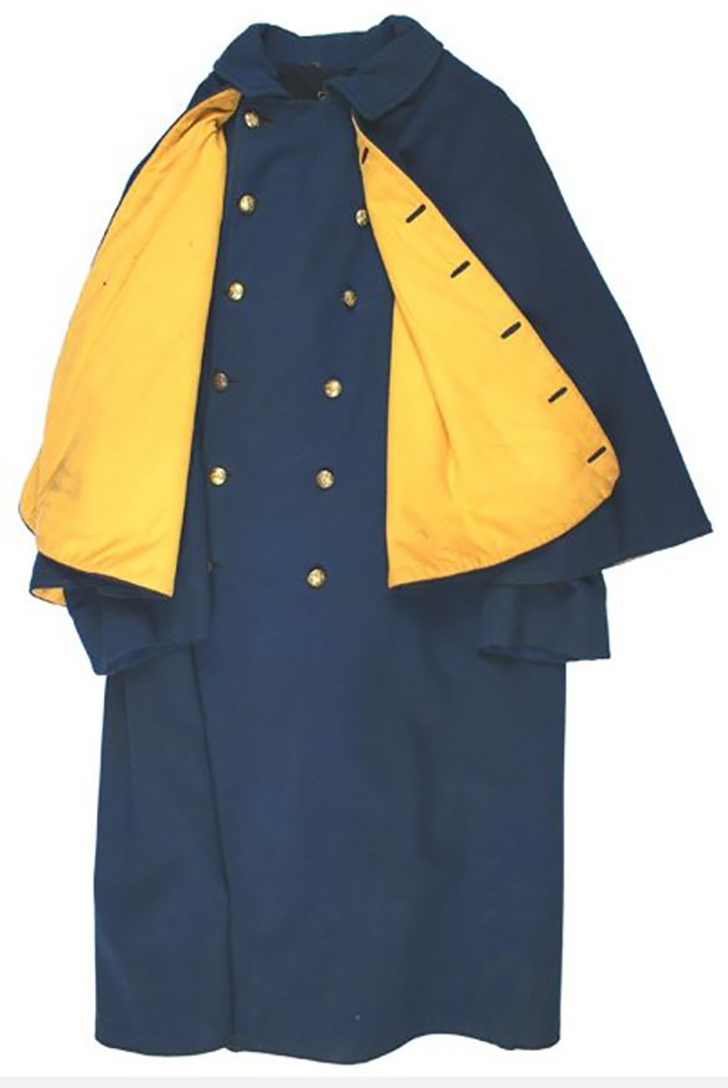 A US Cavalry greatcoat from the Indian Wars, made of blue wool, it is faced in yellow, the branch colouring of the cavalry