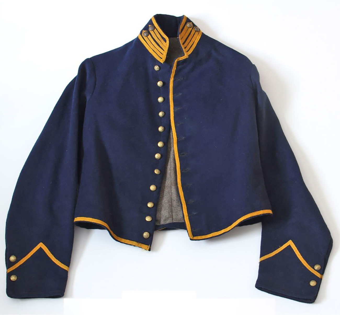 Civil War surplus shell jackets such as this example, piped yellow for cavalry, were popular choices amongst older soldiers for their smart and military appearance