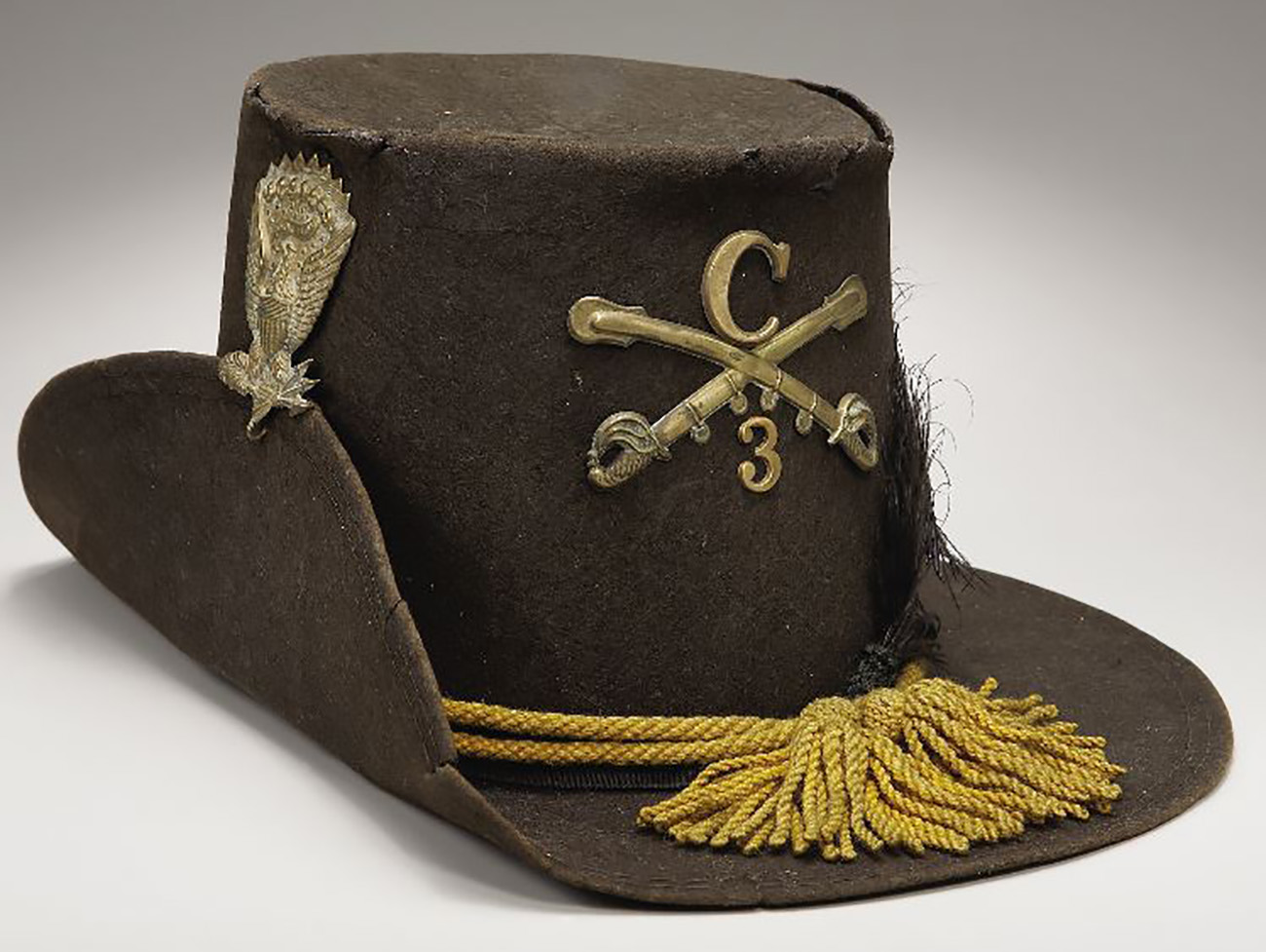 The Hardee hat was made of felt and had been in use since before the Civil War, the yellow cords indicated the cavalry and it at least offered some protection from the sun and rain