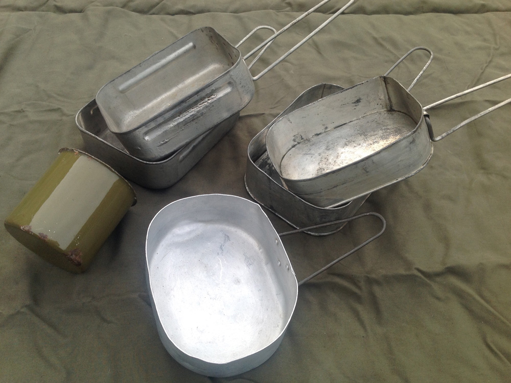 Mess tins used in Burma. British made with a reinforcing rib down each side. Indian made of soldered tin and an oval Indian made aluminium example