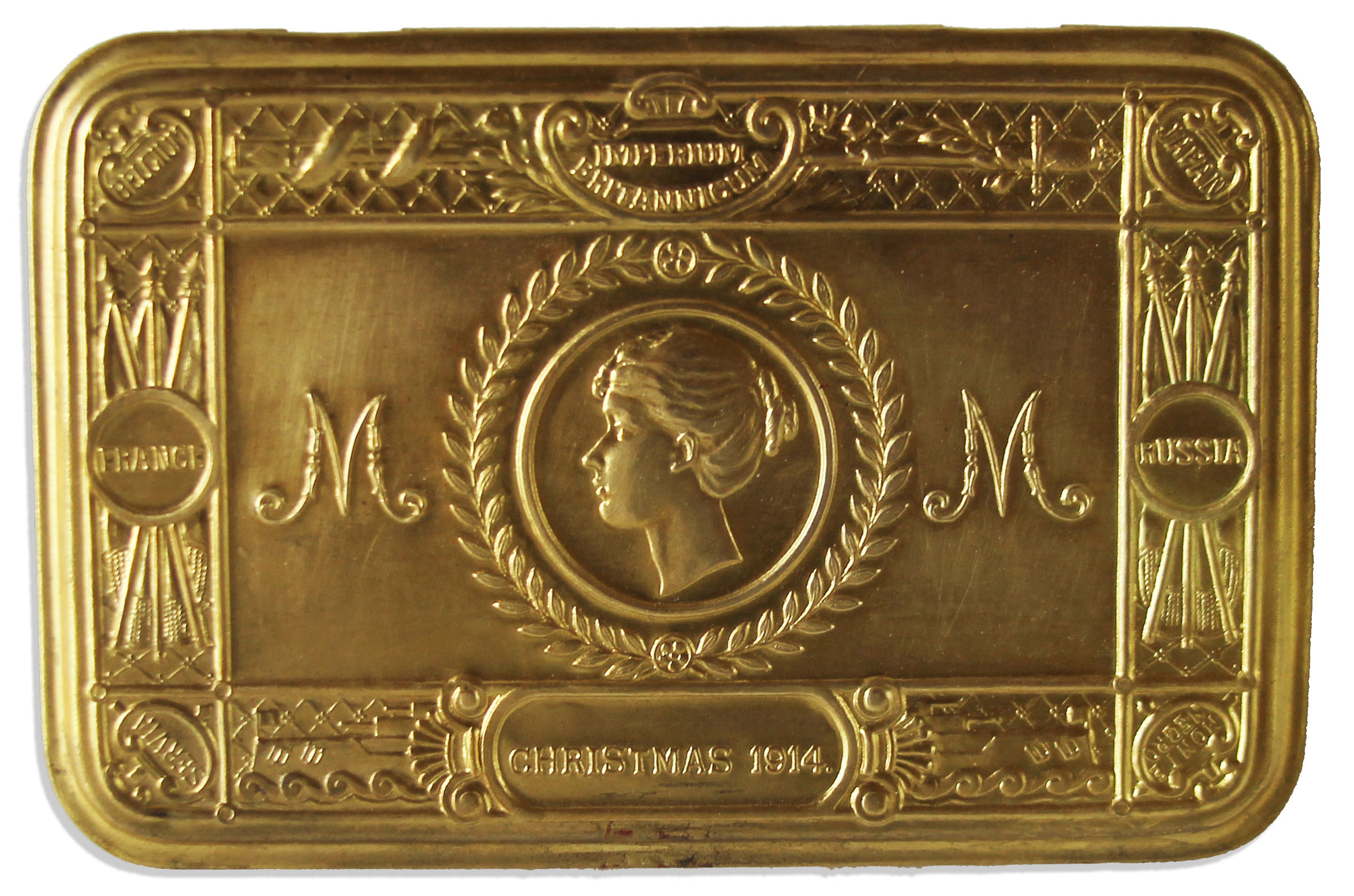 The lid of the brass tin designed for enlisted men, showing Mary's head in profile and the other Imperial symbols