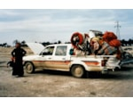 Family and their overloaded car at a refugee centre on the Iraq-Kuwait border, during the First Gulf War, 1991 (c) John Keane
