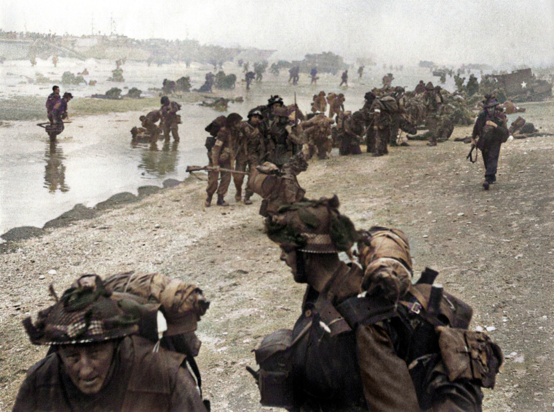 British troops stream up the beaches