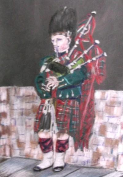 A Piper in the Royal Mile Edinburgh