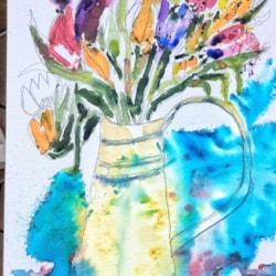 Tulips in an enamel jug