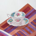 Teacup on Patterned Cloth