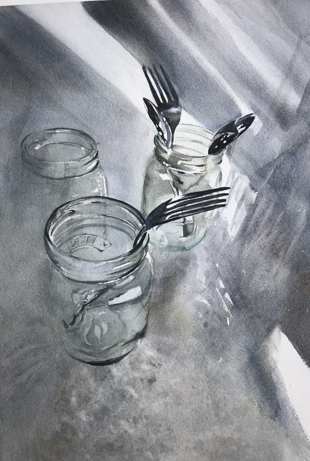 Jars in the sink with a couple of forks and spoons.