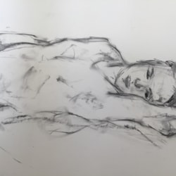 Male nude on bed