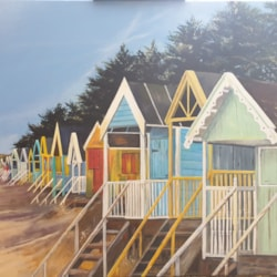 Bright and colourful beach huts. Wells