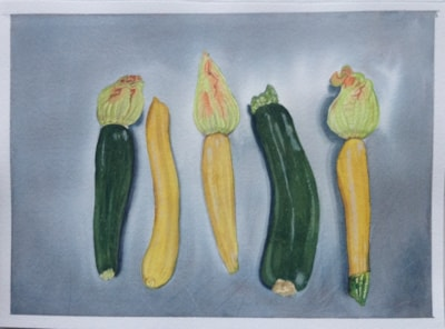Courgettes on stainless steel surface