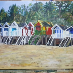 Colourful huts. Wells next to the sea