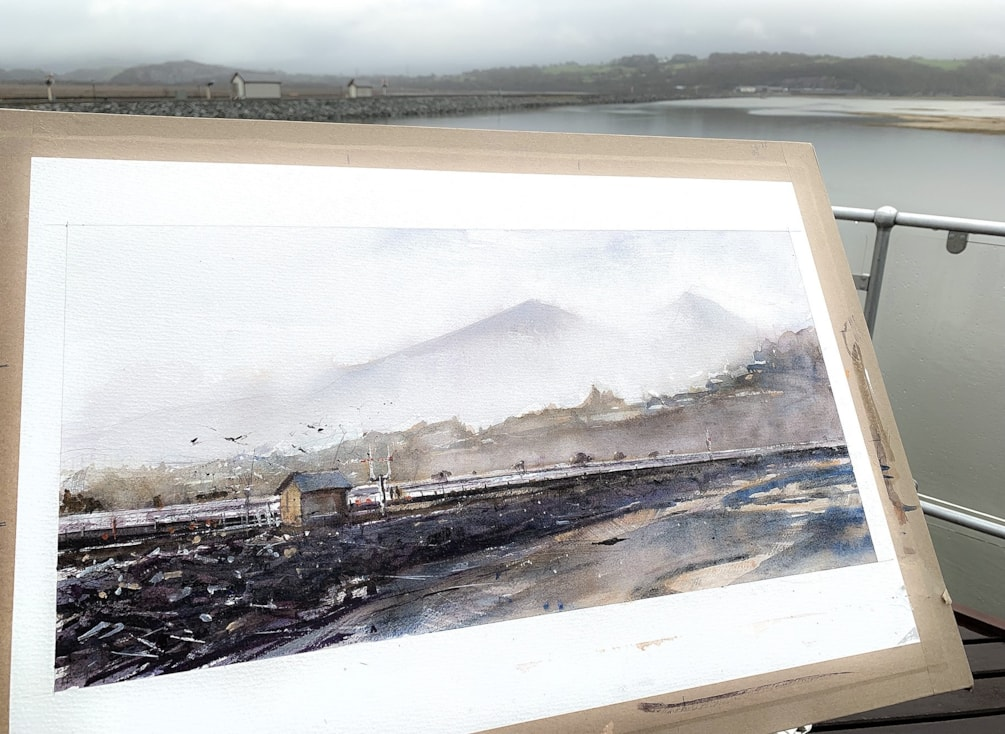 Flooded Glaslyn estuary on a rainy day. Plein air watercolour.
