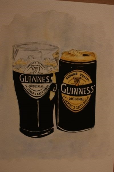 Guinness can and glass
