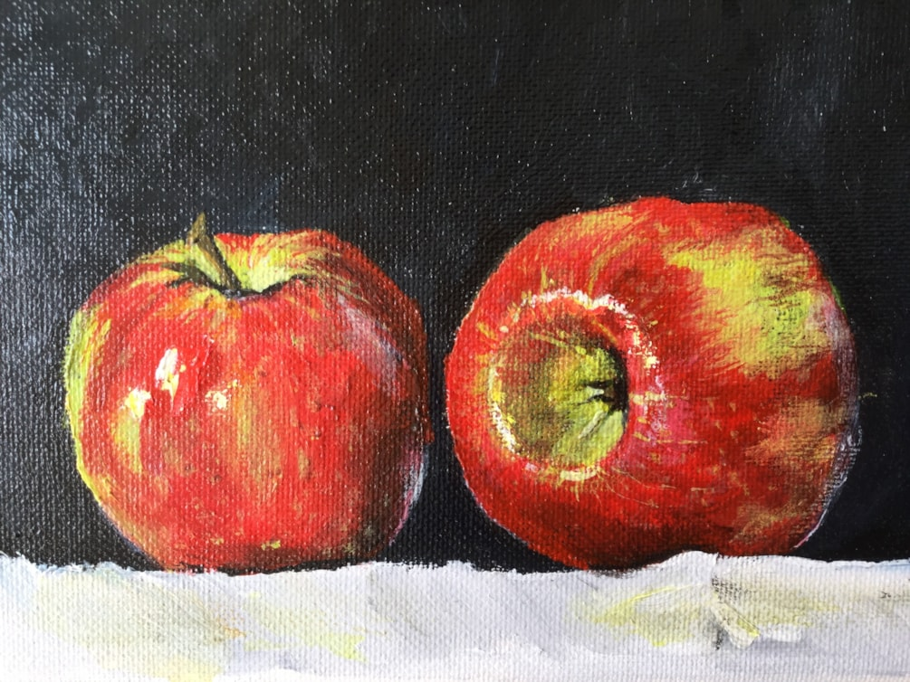 Two red apples