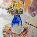Dandelions in a blue jug