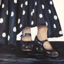 Black flamenco shoes with large spotty dress