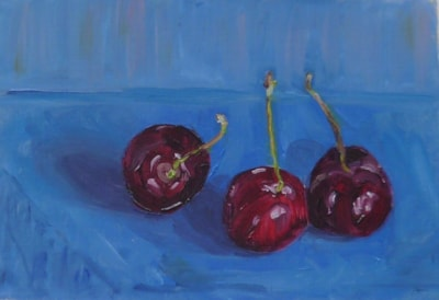 Three cherries on blue