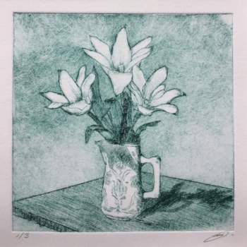A little jug of tulips on green crop to pic