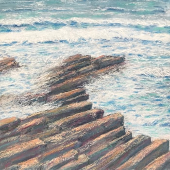 White-plumed waves along the shore