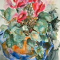 Blue plate with pink plant