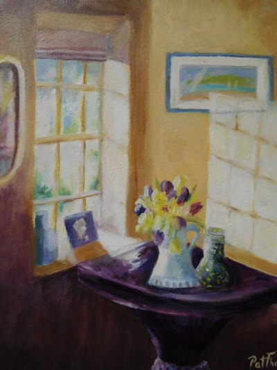 Tulips in sunlit corner