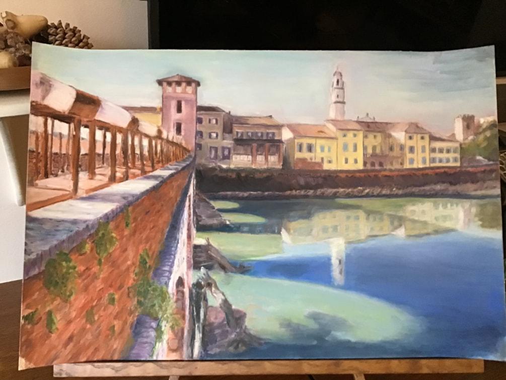 Crossing the Ponte Pietra bridge in Verona Italy