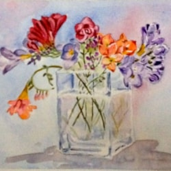 Freesias in a glass vase