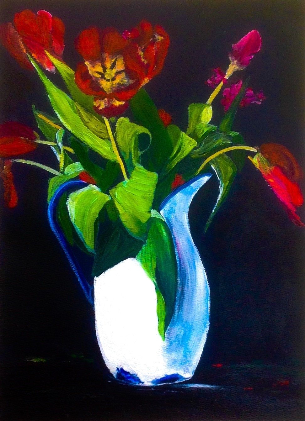 Tulips in an enamel jug.