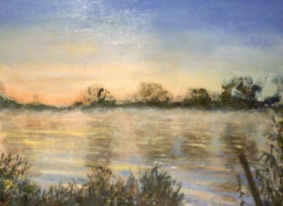 Early morning lake, mist rising