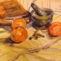 Tagine, pestle, mortar, oranges and cinnamon.