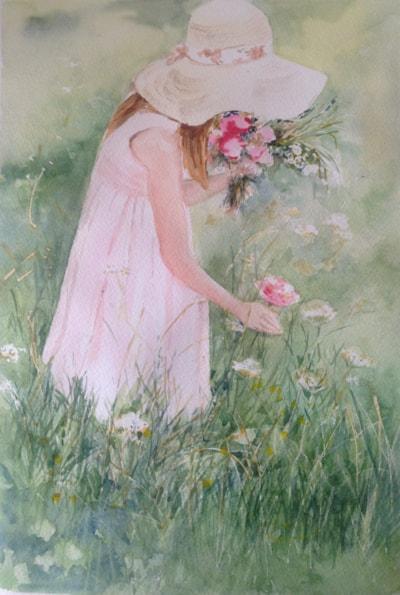 Girl picking wild flowers