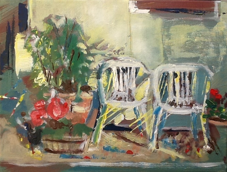 Chairs and begonias