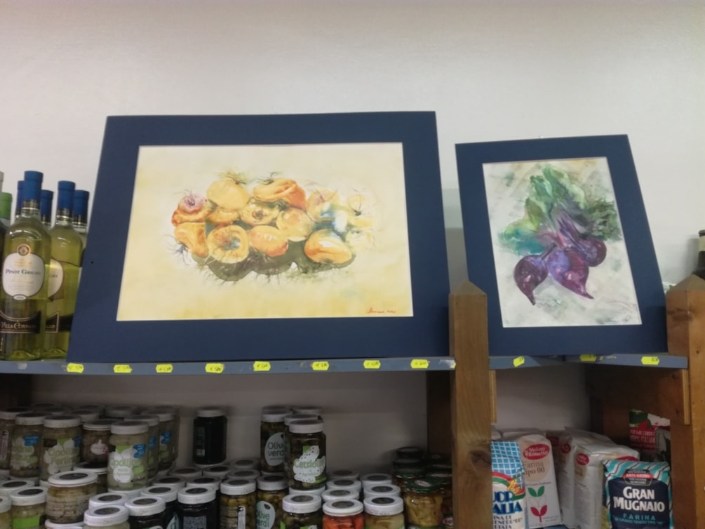 little exhibition at a greengrocer. Red turnips sold to the ownwr.