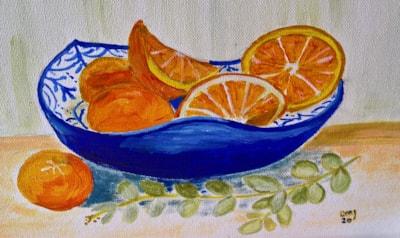 oranges in blue bowl