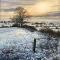 sundown over snowy fields