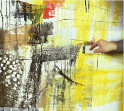 Using a roller to paint in collage
