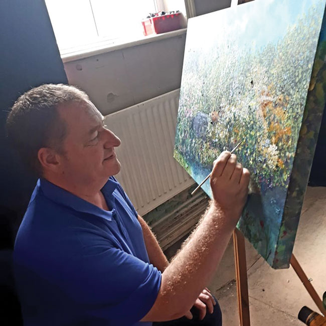 Artist Matthew Evans painting with acrylics